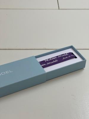 Leces velour violet logo